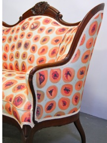 "3) Kate Kern, Our Nation Mourns: Wounded Settee and Footstool, 2013, ink-jet printed fabric on antique walnut camelback settee and footstool, 39"" x 55"" x 41"". Photo courtesy of Kate Kern."